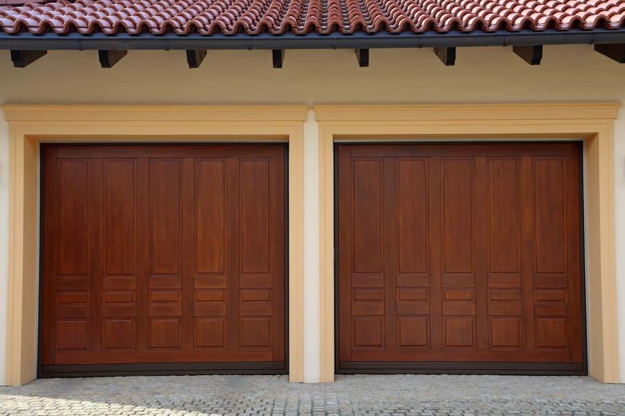 Double garage with wooden doors